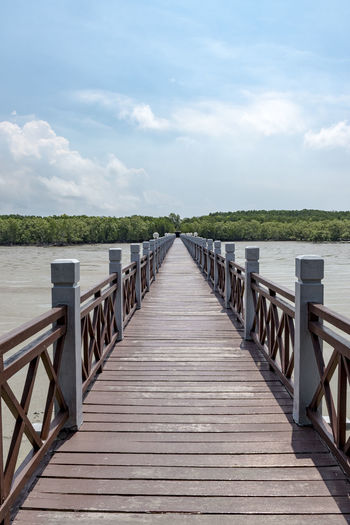 Bridge at Tanjung Pier, Southernmost point of the mainland Asia Beach Beauty In Nature Cloud - Sky Day Diminishing Perspective Jetty Johor Bahru Malaysia Nature No People Outdoors Pier Railing Scenics Sea Sky Southernmost Point In The Mainland Asia SOUTHERNMOSTPOINT Tanjung Piai The Way Forward Tranquil Scene Tranquility Water Wood - Material Wood Paneling The Architect - 2017 EyeEm Awards The Street Photographer - 2017 EyeEm Awards The Great Outdoors - 2017 EyeEm Awards EyeEmNewHere Live For The Story BYOPaper! The Photojournalist - 2017 EyeEm Awards