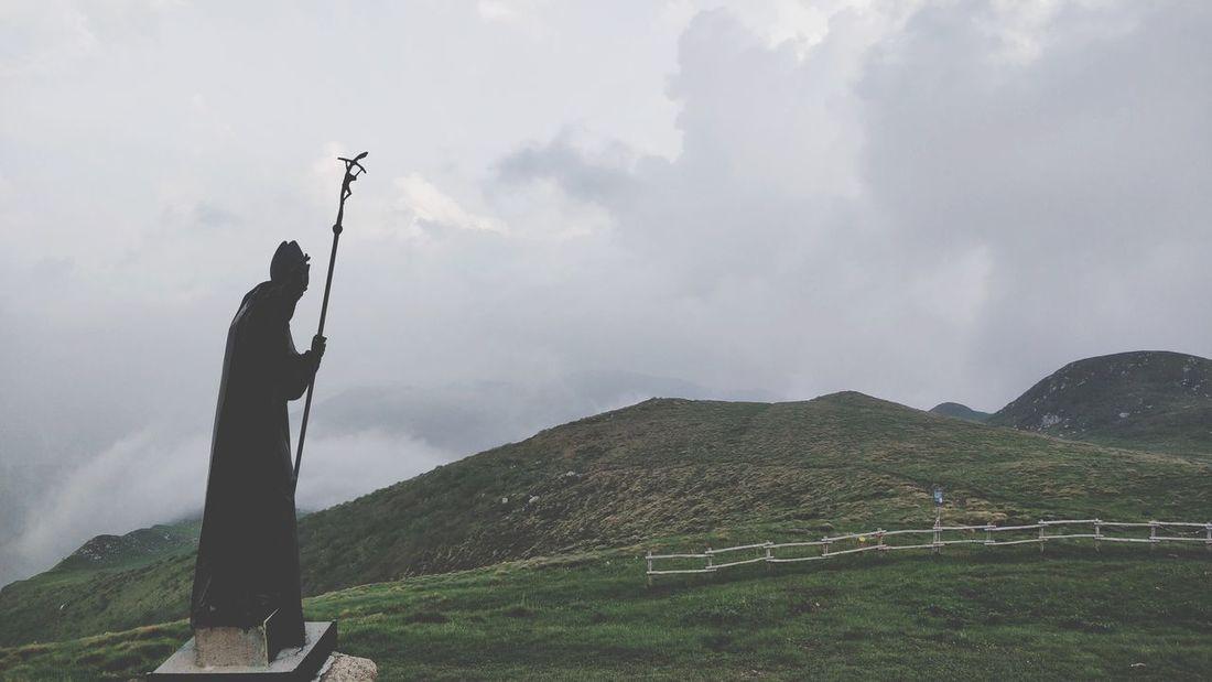 Vigila dall'alto. Religion Statue Pope Paul Cloudy Agriculture Rural Scene Sky Landscape Human Representation