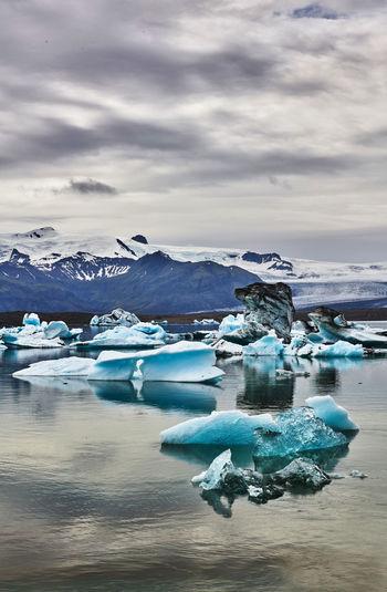 Scenic View Of Ice-Berg In Lake Against Sky