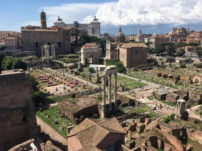 High angle view of old ruin at roman forum against cloudy sky