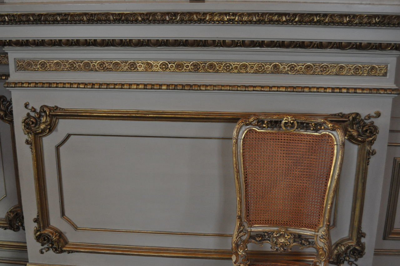 indoors, no people, pattern, gold colored, wood - material, architecture, ornate, wall - building feature, design, antique, frame, close-up, picture frame, built structure, retro styled, metal, floral pattern, still life, home interior, ceiling