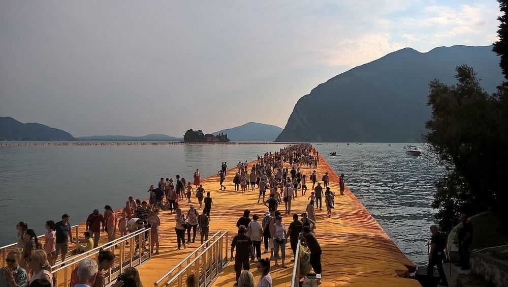 Beauty In Nature Christo Day Floating Piers Group Of People Idyllic Leisure Activity Lifestyles Medium Group Of People Mixed Age Range Mountain Nature Outdoors Scenics Sea Sky Tourism Tourist Tranquil Scene Tranquility Unrecognizable Person Vacations Water