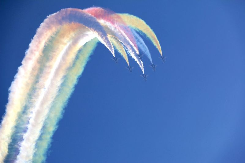 Close-up of vapor trails against blue sky
