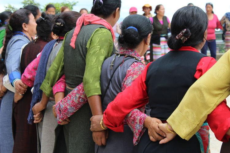 Rear view of folk dancers