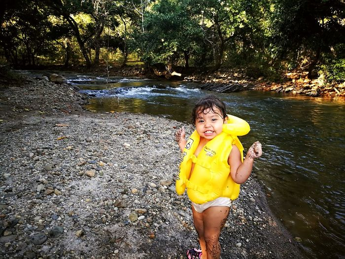 Water One Person One Girl Only Yellow Portrait Outdoors Tree Front View Leisure Activity Summer Childhood Vacations Swimming Pool Day Stream - Flowing Water People