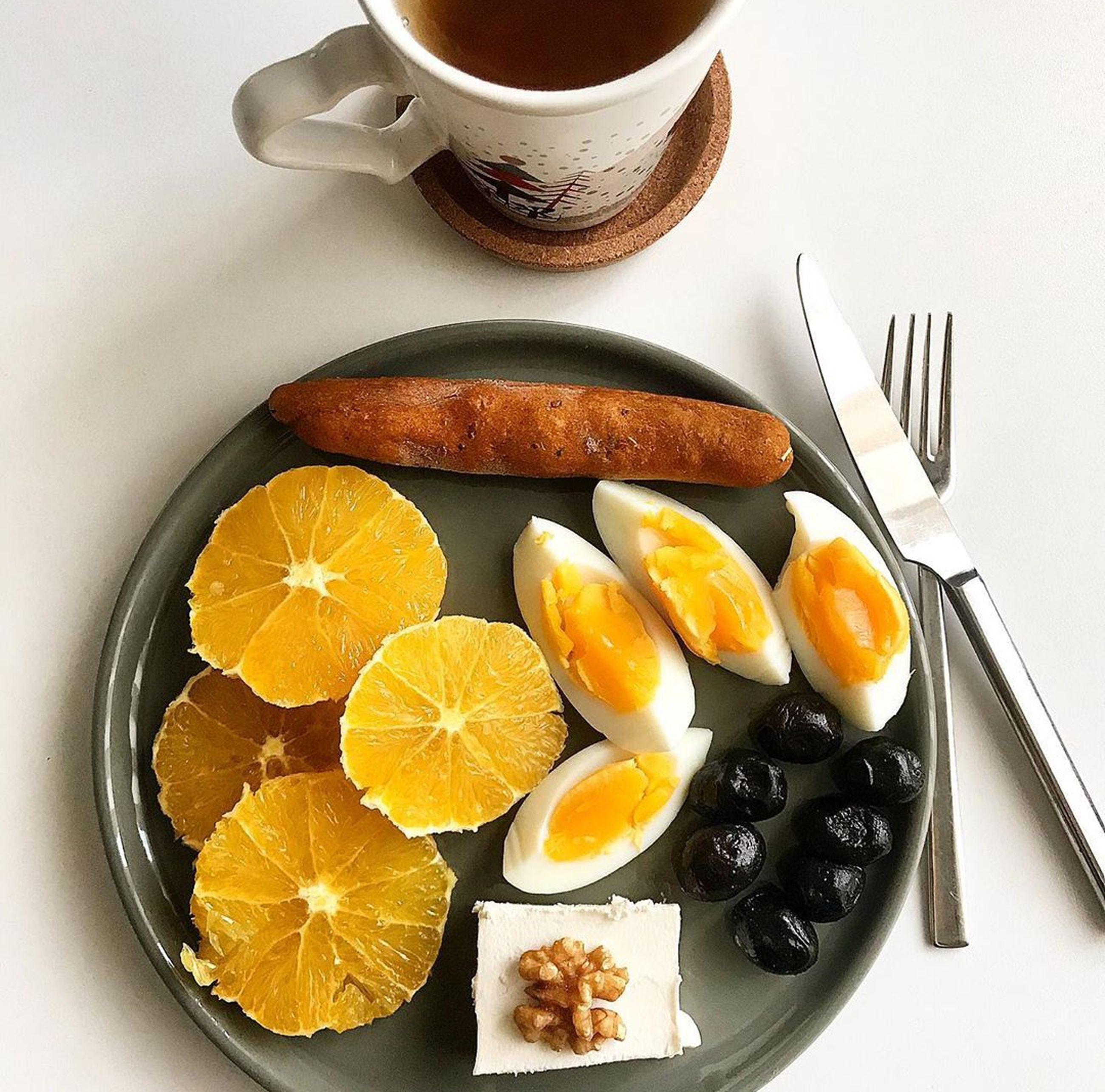 food and drink, food, freshness, eating utensil, kitchen utensil, healthy eating, fruit, wellbeing, still life, citrus fruit, plate, ready-to-eat, indoors, fork, slice, table, spoon, directly above, high angle view, refreshment, no people, orange, breakfast, table knife, temptation, ripe