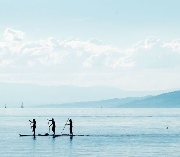 Water Real People Leisure Activity Sky Scenics Men Beauty In Nature Day Waterfront Nature Standing Sea Lifestyles Outdoors Togetherness Two People Sport Full Length Horizon Over Water Paddleboarding