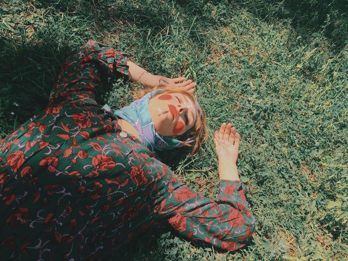 High angle view of woman lying on grass