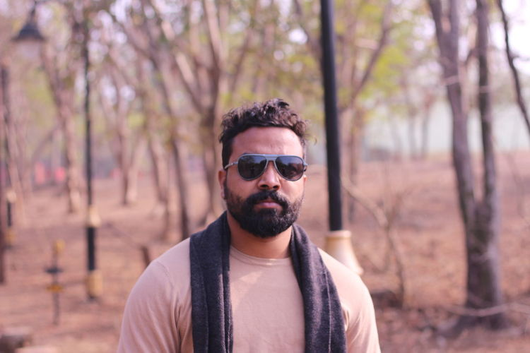 Portrait of an indian male model in a forest