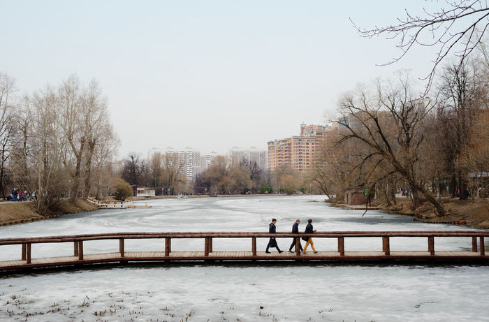 Series: Spring in Vorontsovskiy Park, Novye Cheryomushki District, Moscow Architecture Bare Tree Bridge - Man Made Structure Building Exterior Built Structure City City Life Cold Temperature Day Frozen Leisure Activity Lifestyles Medium Group Of People Men Moscow Nature Novye Cheryomushki District Outdoors Park - Man Made Space Tree Unrecognizable Person Vorontsovsky Park Walking Water Weather