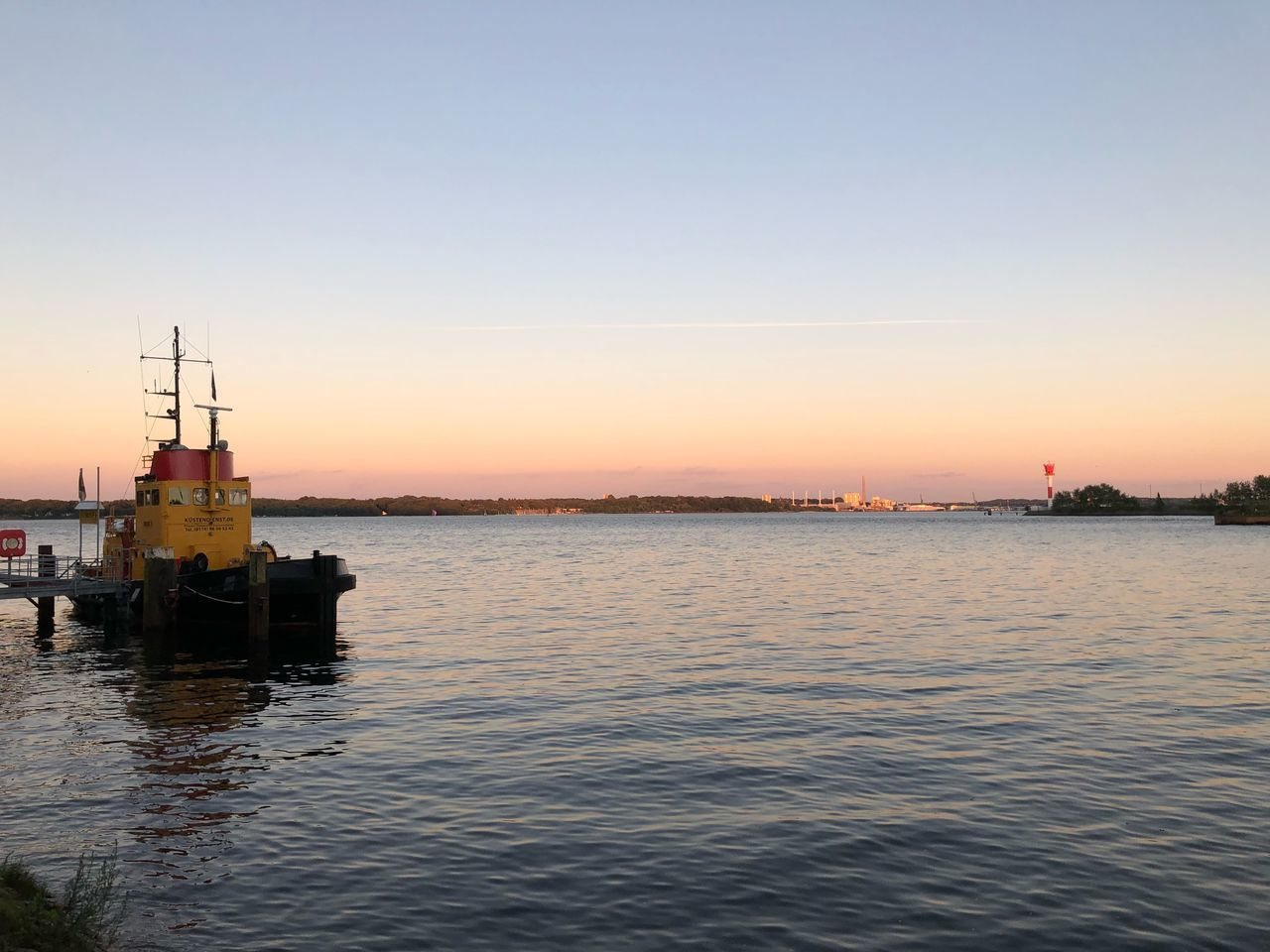 water, sky, sunset, waterfront, sea, beauty in nature, transportation, nautical vessel, architecture, clear sky, scenics - nature, nature, copy space, built structure, reflection, mode of transportation, orange color, no people, tranquil scene, outdoors