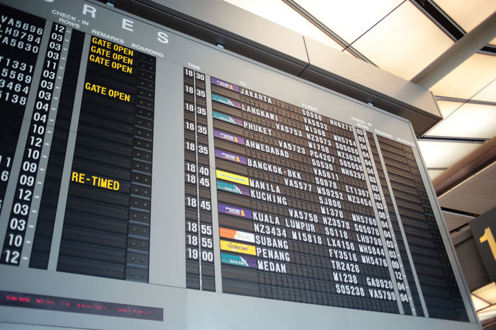 Waiting Airport Arrival Departure Board Checking In Communication Data Departure Indoors  Information Medium Low Angle View Technology Traveling Home For The Holidays Long Goodbye