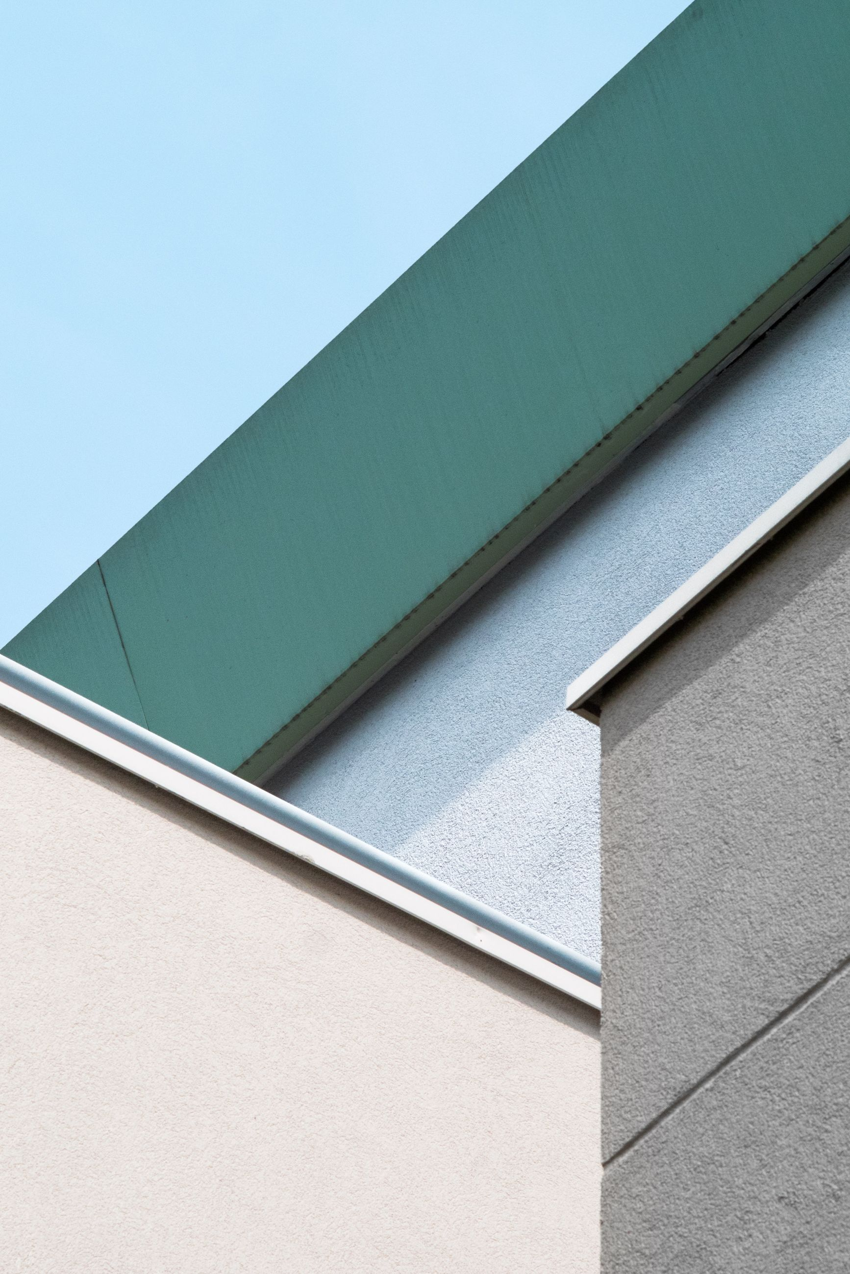 architecture, built structure, building exterior, no people, low angle view, day, building, blue, sky, copy space, outdoors, wall - building feature, clear sky, roof, window, nature, close-up, sunlight, green color, pattern, turquoise colored