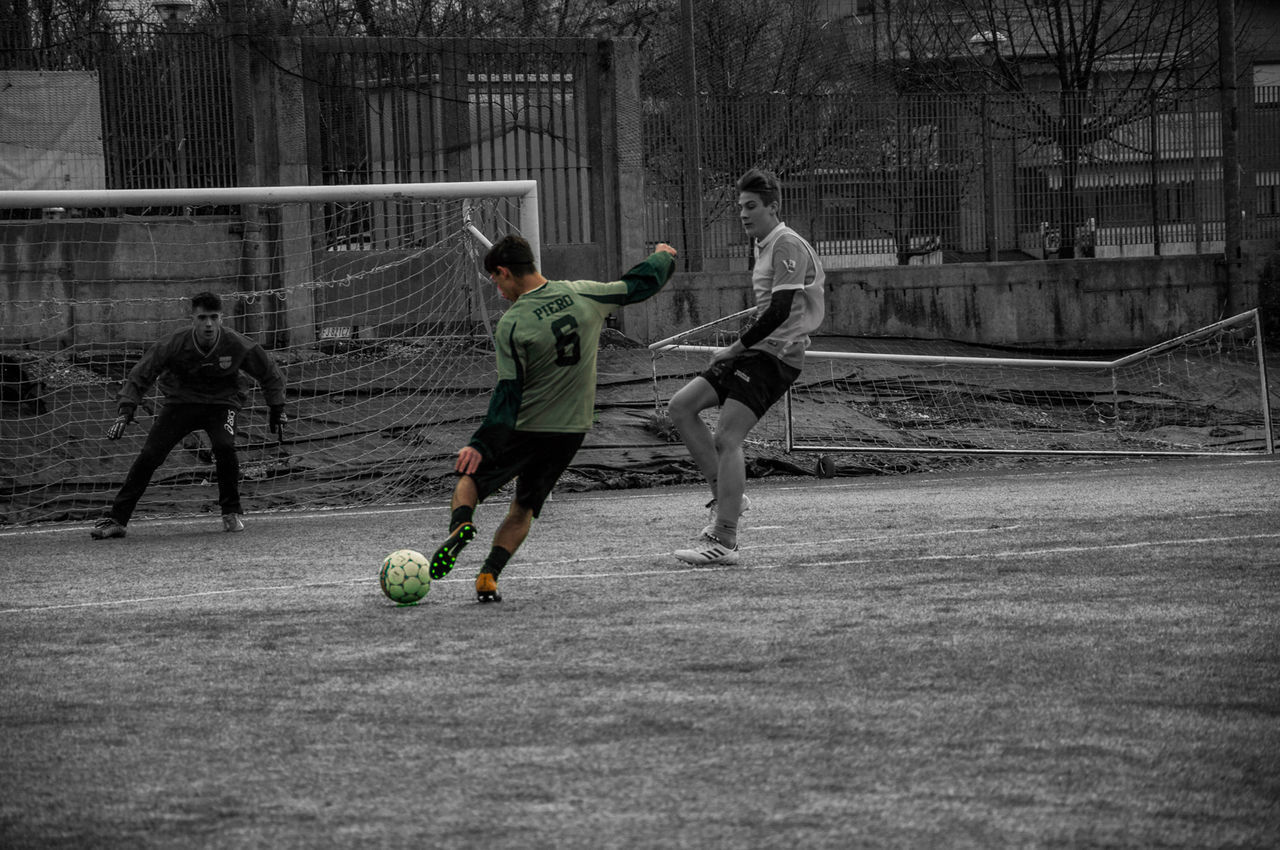 sport, playing, soccer, real people, team sport, ball, men, motion, full length, soccer ball, running, sports equipment, lifestyles, leisure activity, athlete, boys, group of people, people, males, child, skill, outdoors