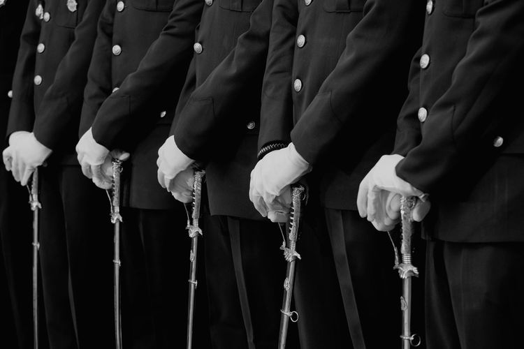 Midsection Of Soldiers Standing