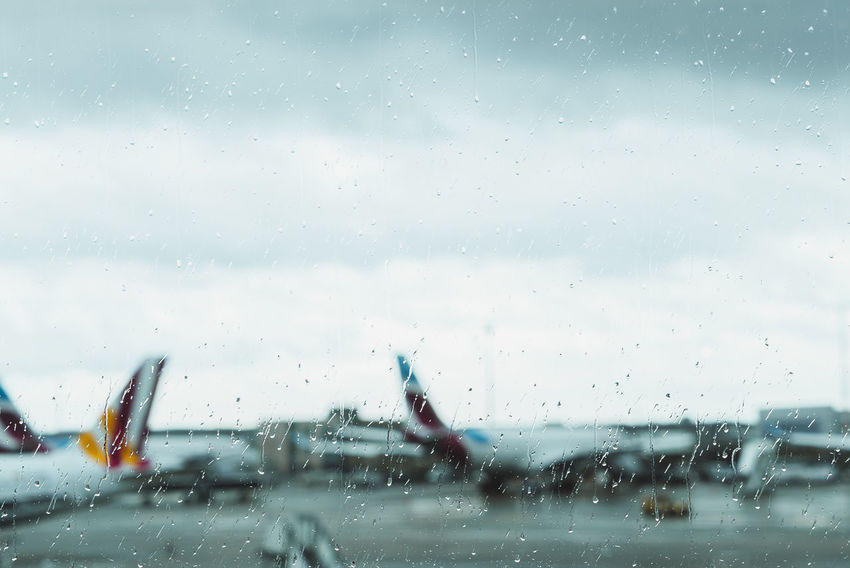 Grounded airplanes on a rainy day Air Vehicle Airplane Drop Glass - Material Land Vehicle Looking Through Window Mode Of Transport No People Rain RainDrop Rainy Season Runway Sky Transparent Transportation Travel Vehicle Interior Weather Wet Window