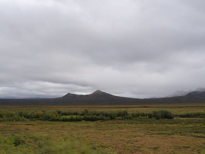 Beauty In Nature Canada Cloud - Sky Day Dempster Highway Grass Landscape Mountain Mountain Range Nature No People Outdoors Scenics Sky Tombstone Territorial Park Tranquility Weather Yukon