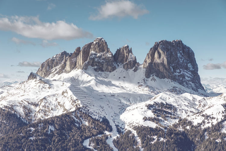 Scenic view of snowcapped mountains against sky near passo sella, dolomiti superski, italy