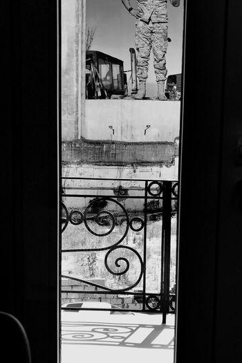 Buildings seen through window of house