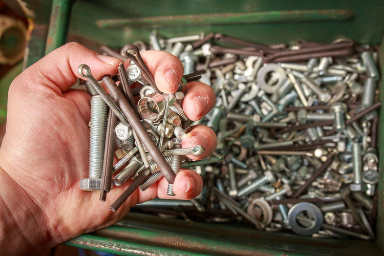 Close-up Complexity Day Human Body Part Human Hand Indoors  Industry Mechanic Men Metal Nut - Fastener One Person People Rusty Screw Transportation Vehicle Part