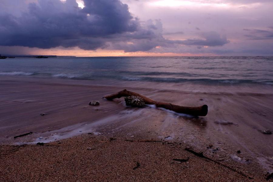 Slow in Kuta Bali, Indonesia Bali Balinese Garuda Wisnu Kencana Baliphotography EyeEm Selects Kutabeach Beach Sand Sunset Dramatic Sky Landscape Sea Cloud - Sky Horizon Over Water Wave Outdoors Dusk Red Sun Silhouette Sky Sunny Backgrounds Social Issues Abandoned Nautical Vessel