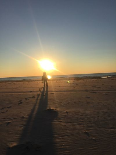 My son wishing it was the start of Summer and not the start of 2015. At The Beach During The Winter  Sunrise