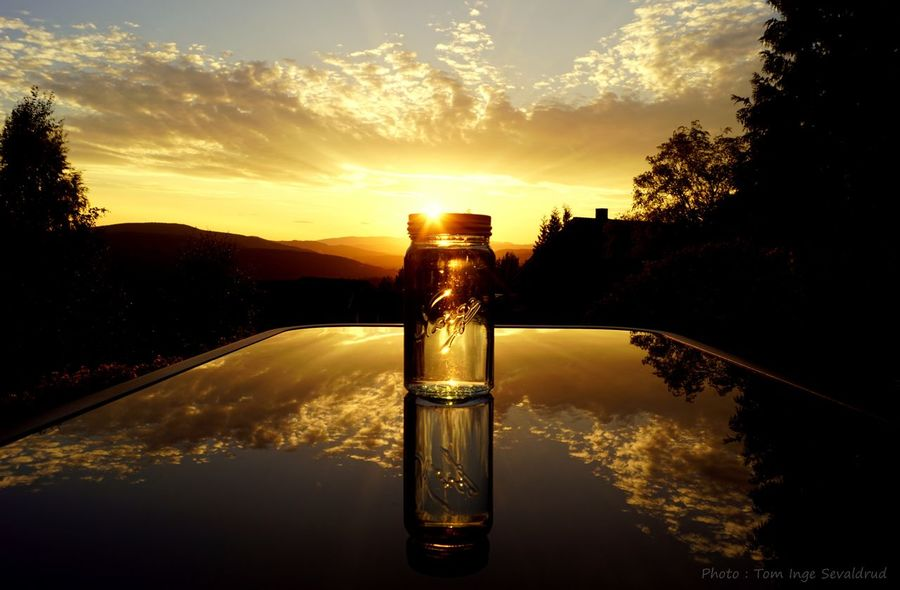 Photoart Norgesglass Creativephoto Sunset_collection Sunset Sky Nature Water Tree Plant No People Sunlight Cloud - Sky Sun Glass - Material Reflection