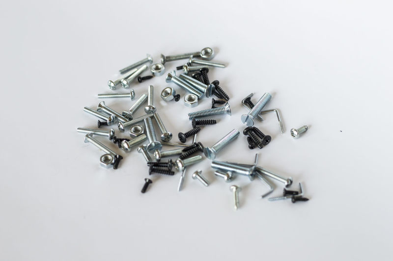 High angle view of keys on table against white background