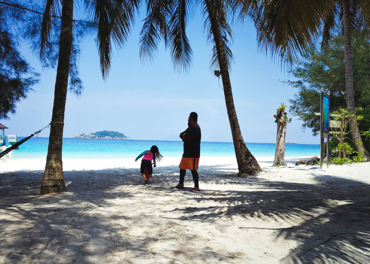 Pulau Redang, Terengganu, Malaysia. Tree Real People Water Land Two People Beach Nature Sea Sky Plant Palm Tree Rear View Women Tropical Climate Lifestyles Leisure Activity Beauty In Nature Togetherness Adult Positive Emotion Outdoors