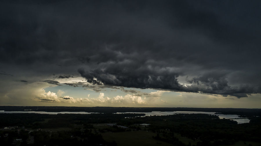 A dramatic summer storm rolls over Crab Orchard Lake in Carterville, Illinois. Drone  Illinois Storm Stormy Weather Aerial View Beauty In Nature Cloud - Sky Dark Dramatic Sky Environment Horizon Nature No People Ominous Outdoors Overcast Power Power In Nature Scenics - Nature Sea Sky Storm Storm Cloud Thunderstorm Water