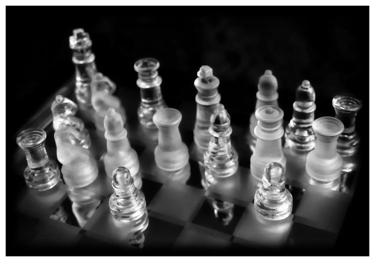 Leisure Games Board Game Game Chess Chess Piece Relaxation Indoors  Strategy Leisure Activity Chess Board Competition No People Arts Culture And Entertainment Close-up Studio Shot Large Group Of Objects Transfer Print Challenge Black Background In A Row Order King - Chess Piece Pawn - Chess Piece Queen - Chess Piece Knight - Chess Piece
