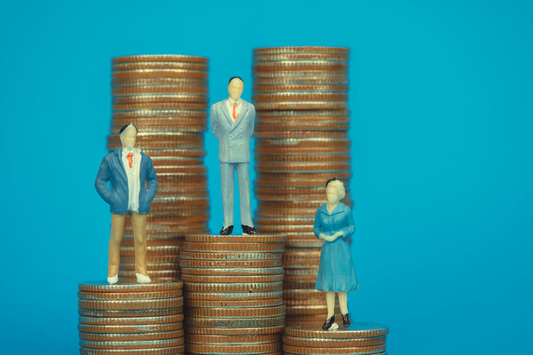 Figure miniature businessman or small people investor and office worker secretary standing on coin stack, for money and financial business success concept idea Bank Banking Business Businessman Cash Challenge Coin Concept Cost Currency Economy Figure Finance Financial Growth Income Invest Investment Market Miniature Money People Profit Retirement Save Savings Secretary Stack Stock Success Tax Top Vision Wealth Work