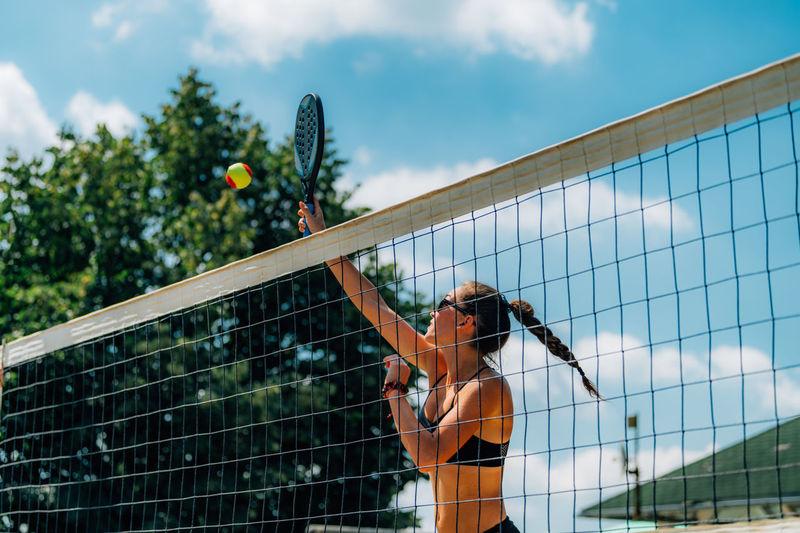 Beach tennis player at the net
