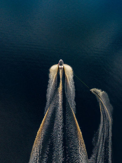 High angle view of rope hanging over sea