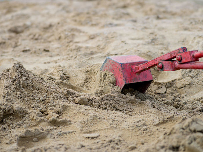 Close-up of toy on sand