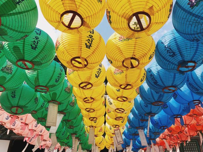 Low angle view of lanterns hanging in row