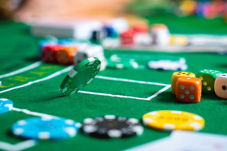 Close-up of colorful gambling chips on table