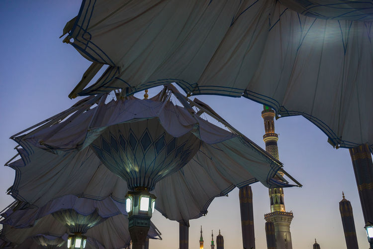 MEDINA, SAUDI ARABIA - 17TH NOV 2017; Morning view of minarets and big umbrellas of Nabawi Mosque. Nabawi mosque is the second holiest mosque in Islam and built in 622. Architecture Eid Al Fitr Eid Mubarak Medina Al Munawarah Middle East Morning Light Nabawi Mosque Peace And Quiet Pray Prophet Muhammad Saudi Arabia Shrine Tomb Tranquility Arabic Autonomous Eid Adha First Light Holy Place Minaret Pilgrim Sunrise Technology Tower Umbrella
