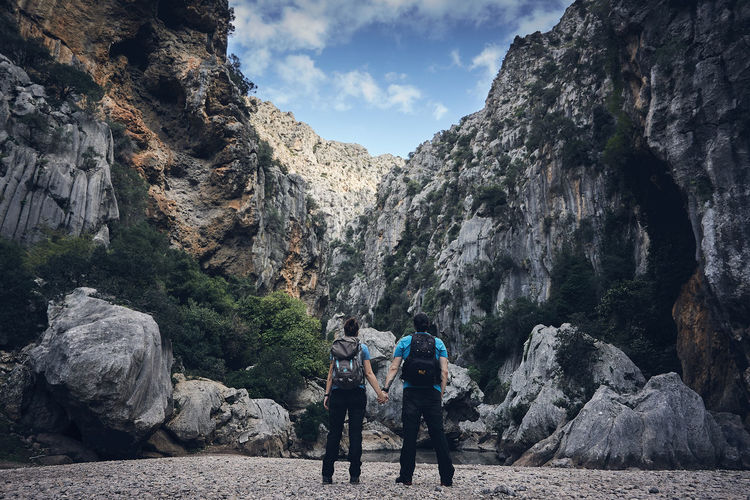 Adventure Backpack Beauty In Nature Day Geology Hiker Hiking Leisure Activity Lifestyles Men Mountain Nature Outdoors Physical Geography Real People Rear View Rock - Object Rock Formation Scenics Sky Togetherness Travel Two People Walking Women Be. Ready.