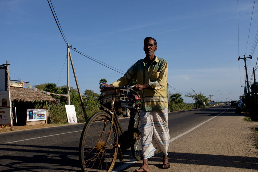 Travel in Sri Lanka Adventure ASIA Bicycle Cable Cycling Enjoying Life Exciting Exploration Explore Front View Full Length Land Vehicle Mature Adult Mode Of Transport One Person Real People Road South Asia Sri Lanka Sri Lankan Transportation Travel Photography Traveling The Street Photographer - 2017 EyeEm Awards The Portraitist - 2017 EyeEm Awards Let's Go. Together.