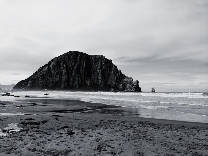 Scenic View Of Beach And Rock Formation Against Sky