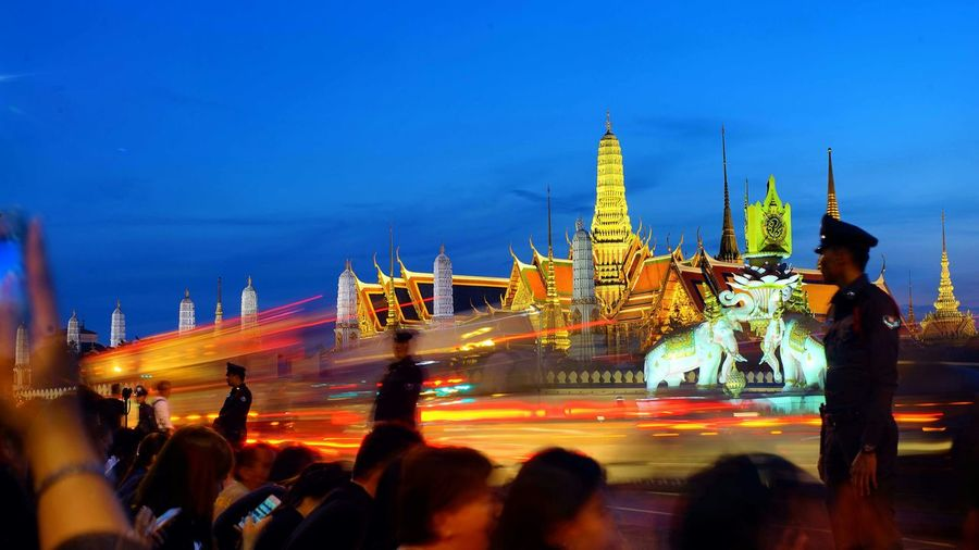 Adult Architecture Bangkok Thailand Blurred Motion Built Structure City City Life Cityscape Crowd Emerald Buddha Temple Large Group Of People Lifestyles Long Exposure Men Motion Night Outdoors People Real People Sky Travel Destinations Women