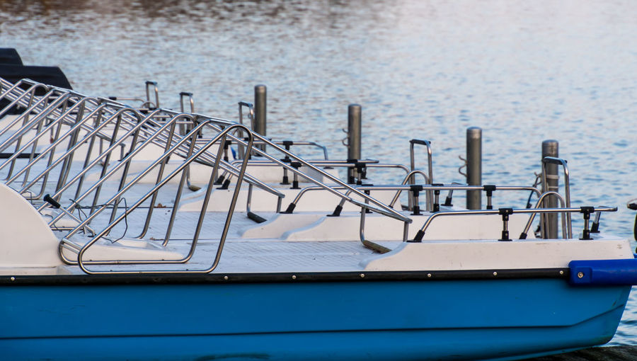 Close-up of pedal boats moored on sea