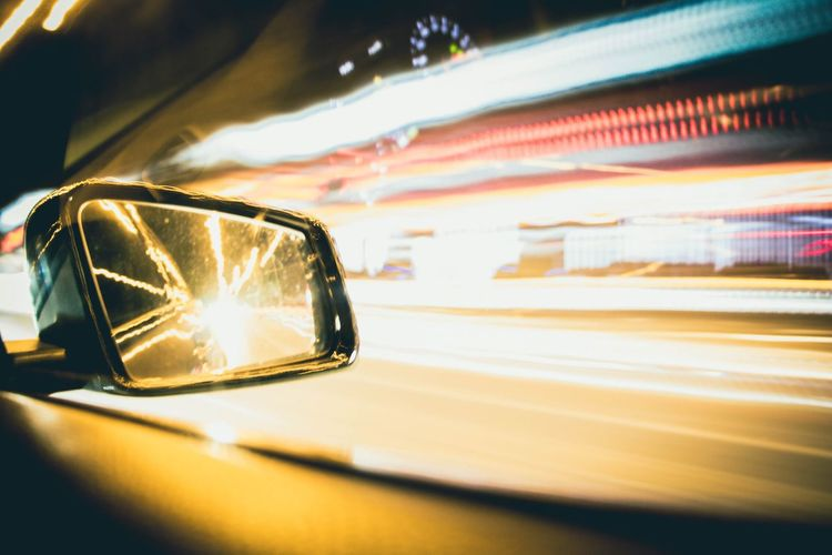 Fast Cars & Street Lights Slow Shutter Speed Motor Vehicle Illuminated Mode Of Transportation Land Vehicle Transportation Motion Reflection Speed Street Blurred Motion City Side-view Mirror Outdoors Night First Eyeem Photo