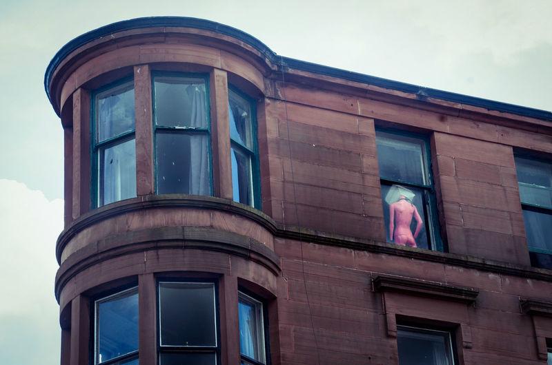 City Day Glasgow  Scotland Scottish Sandstone Flats Bay Window Mannequin Window Odd Pink Neon Figure In Window Art Decoration Battle Of The Cities Art Is Everywhere