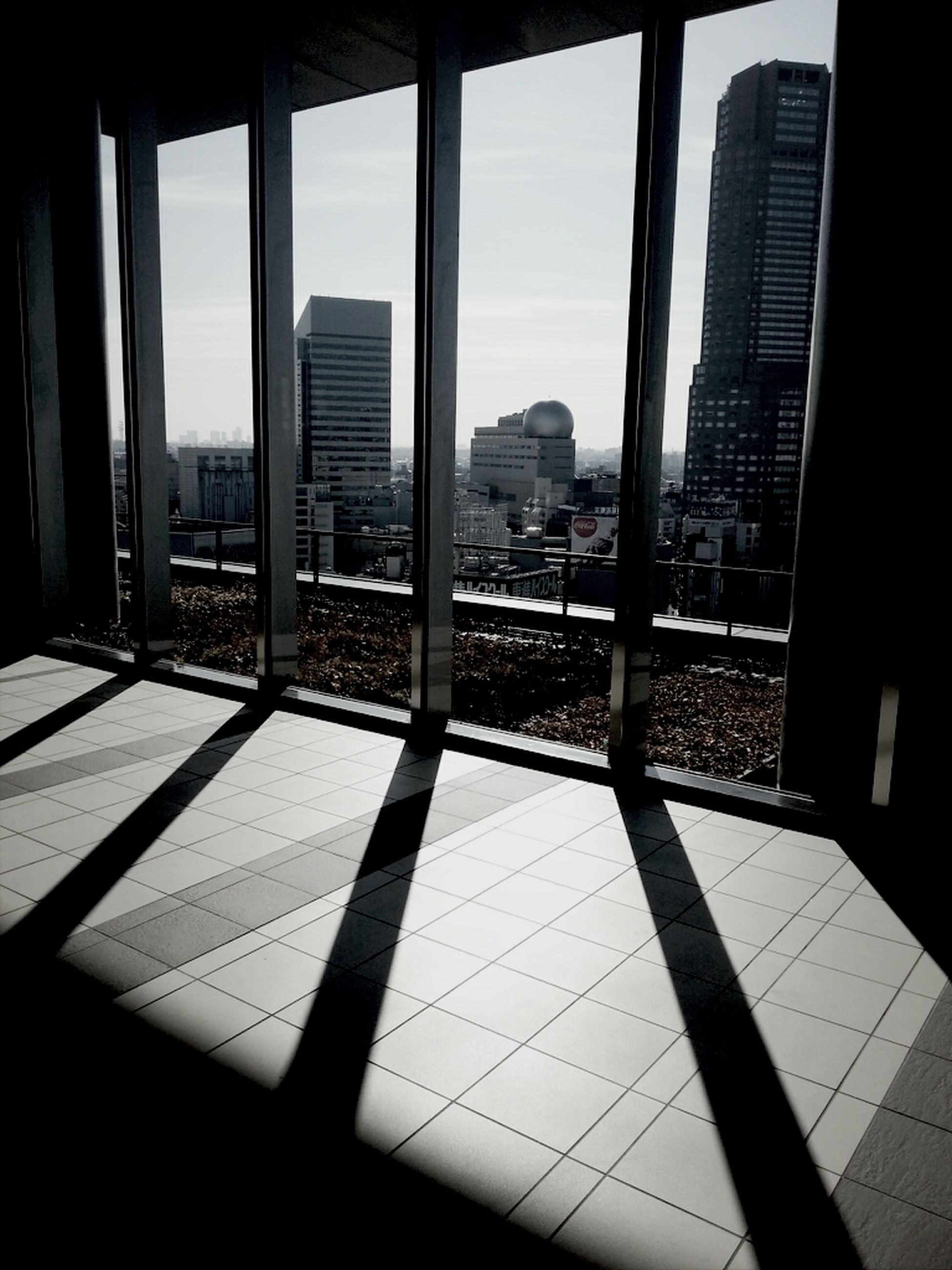 architecture, built structure, building exterior, city, indoors, modern, glass - material, office building, window, skyscraper, building, sunlight, shadow, reflection, tall - high, day, sky, tower, transparent, cityscape