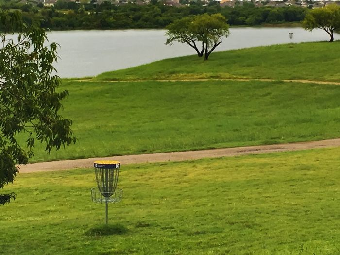 The Color Of Sport Tranquil Scene Diskgolf Disk Grass Tree Bench Water Empty Landscape Absence Scenics Green Color Solitude Lake Non-urban Scene Lawn Nature Growth Plant Day Countryside