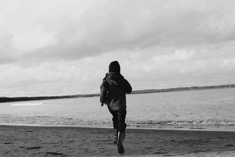 The Running Little Man Ostseeküste in Germany Nature Sea And Sky Free Outdoors Balticsea Canonphotography Photography In Motion Water Vacations Lovely Blackandwhite Photography Blackandwhite Boy Running Child EyeEm Gallery BYOPaper! Live For The Story My Best Photo