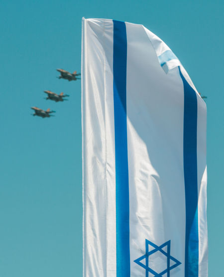 Airplanes Performing Airshow With Israeli Flag In Foreground During Independence Day