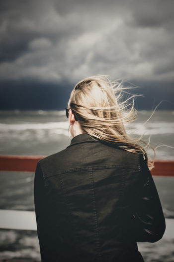 Baltic Sea Lithuania Storm Adult Blond Hair Cloud - Sky Day Focus On Foreground Girl Hair Hairstyle Jacket Long Hair Looking At View Nature One Person Outdoors Real People Rear View Sea Sky Standing Waist Up Wind Women